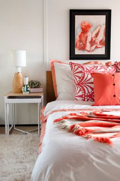 Coral hotel bedding from Crane and Canopy with West Elm accent pillow and throw….