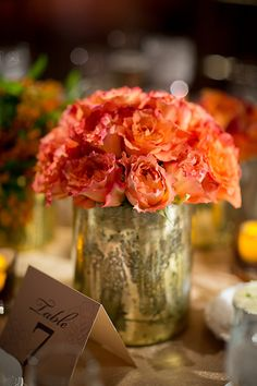 Free spirit roses in mercury vases are great centerpieces for a fall wedding | Brides.com