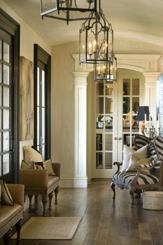 dark doors- light floors & creamy trim...