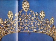 A diamond belle epoque tiara, circa 1880. Designed as a series of intertwining scrolls and foliates, with diamond cluster, and known as the 'Borhese tiara', an old noble family of Italy.