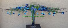 Armature with blue orchids and hyacinth. Tony Medlock AIFD