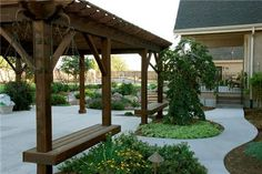 pergola with built in benches. . .