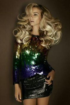Glam. Fabulous hair. And dress. Hot.