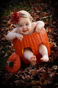 Baby girl in pumpkin, how cute!