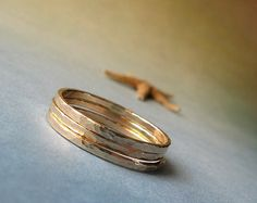Modern simple trio of 14k gold filled stacking rings.  Textured everyday jewelry.  Made to order.  Minimalist hammered accessories.