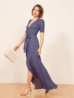 Some people say our dresses are the best. Maybe you should try one on. This is a midi length, wrap dress with slightly puffed shoulders and a v neckline.