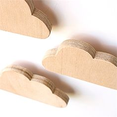 Check out this fabulous DIY you can add to any room in your home! These floating wooden clouds are both whimsical and modern!