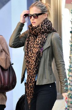 Street fashion leopard scarf and olive jacket.