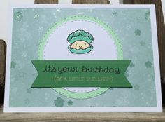 This handmade birthday card is a puntastic play on words made cute by an adorable little smiling pearl sat in its shell. A funny card, this pearl card has a glittered floral green background with mint green & white Memory Box Stitched Circles in the centre.  Atop the circles sits the adorable Lawn Fawn Year Six pearl. Stamped onto Neenah White Cardstock with Memento Tuxedo Black ink the shell is coloured with Spectrum Noir pens giving a depth and shape to the shell which has then been coa...