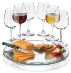 """Libbey Wine Service with Six Wine Glass/One Platter and One Cheese Knife, 8-Piece, Clear by Riekes Distribution-Drop Ship. $29.95. Great wedding, housewarming, or host gift. Glasses made in usa, platter made in mexico, cheese knife made in china. Six 12.75 ounce clear all-purpose wine glasses,  one 12.9"""" clear platter,  one cheese knife. Glasses and platter are dishwasher safe  Hand washing is recommended for the cheese knife. Made of glass, metal and wood. This ..."""