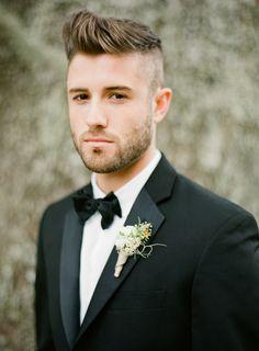 handsome groom in a modern black tux