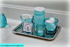 Dollar Tray Holds Aqua Accessories And Candles