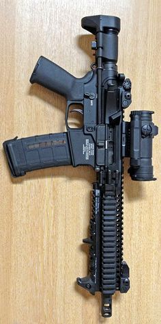 LANTAC SBR goodness.  Very interesting- Modified recoil spring and carrier? MP5 style stock as well.