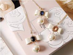Crystal Bijou Ribbon & Swing Pearl Necklace by CharisJewel on Etsy, $17.00