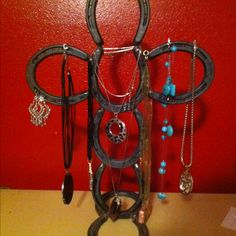 Horseshoe necklace holder....Having my dad make this for me!