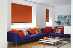 If you're looking for a bold, bright colour to really make a statement in your home, our Vitra Action Roller Blind is perfect for you. This stunning orange blind is perfect for anyone who loves a bit of colour and we think it looks fantastic in this contemporary living room. The perfect statement accessory.