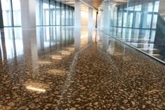 Deep grind Bomanite Renaissance polished concrete floor constructed for Cerner by Bomanite licensee Musselman and Hall with offices, showrooms and architect support staff based out of Kansas City and St Louis MO. St Louis Mo, Polished Concrete, Concrete Floors, Railroad Tracks, Offices, Kansas City, Renaissance, Construction, Deep