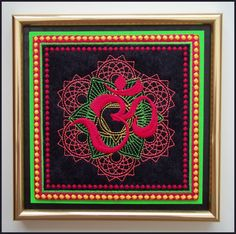 "Machine embroidered ""Om"" picture in gold frame with glass, neon colours, aum, om, Buddhism, black embossed card, measures 6.5ins x 6.5ins. by CushionRock on Etsy"
