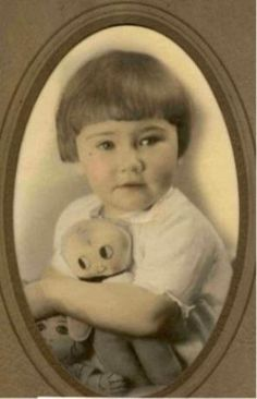 Vintage photo of a cute little girl named Patricia Covey (born March 25,1924) holding her doll.
