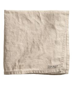 linen beige. PREMIUM QUALITY. Napkin in washed linen with printed stamp detail and double-stitched edges. Tumble drying will help keep linen soft.