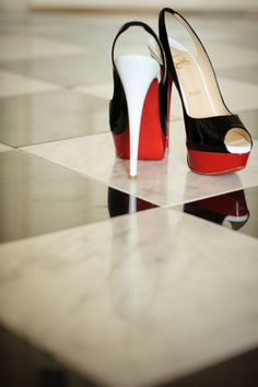Red, black & white Louboutin shoes