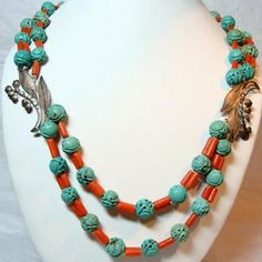 Chinese Coral Tube Beads and Carved and Pierced Turquoise Beads. Silver Lily of the Valley flower Accents.
