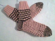 """Lithuanian Amber design from """"Folk Socks"""" book by Nancy Bush. Knitted these on circular needles using the 2 socks at one time technique that I learned at Yarnorama. A bit tricky keeping up with 4 balls of yarn but well worth the effort."""