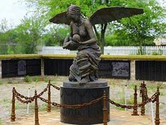 A black mother as an Angel carrying a baby to heaven is built in the middle of the field at the Whitney plantation 'in Wallace, Louisiana