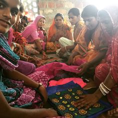 The women of the Saheli Centre deciding colour schemes for our new bags.