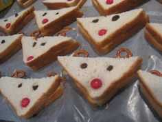 A Toddler Christmas Party - PB with raisins for eyes & an M nose