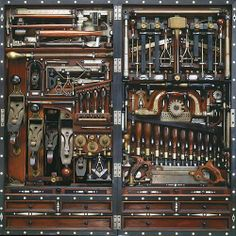The Studley Tool Chest holds 300 tools, yet measures only 9 in. deep, 39 in. high, and 18 in. wide, when closed (22.86 x 99.06 x 45.72 cm). Every tool has a custom-made holder to keep it in place, many with beautiful inlay, and tiny clasps that rotate for easy access. As the chest folds closed, tools from the left side nestle precisely between tools on the right side.