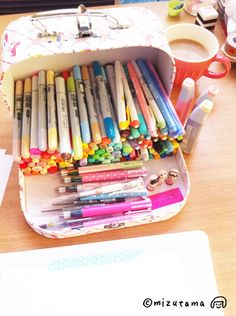 """Mizutama's Copic Markers. I love that """"suitcase"""" as a holder for the desk. Ideas..."""