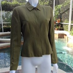 Anne Taylor Snazzy jacket This fully lined jacket is a green khaki color. Made of linen and rayon.  Lightweight. The front of the jacket closes with buttons that don't show - check photo.  Gently loved! Ann Taylor Jackets & Coats