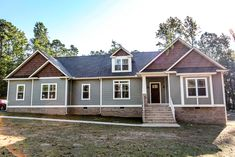 #Craftsman style rancher home with vinyl siding, wood shingle accents, and stone veneer ©Balducci Builders, Inc.