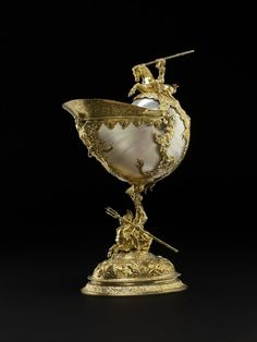 nautilus shell mounted in silver, gilt and chased; cup has broad band round lip, engraved on outside with sea-monsters; supported at sides by. Vases, Mythological Characters, Shell Decorations, Nautilus Shell, Sea Dragon, 3d Models, Sea Monsters, Shell Art, Museum Collection