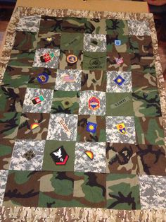 Jerry - Service, Front  This quilt was made from material from my ex husbands uniforms, unit, rank and name patches,  all covering his military career.  It was given to his father.