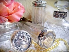 Vintage leaded glass vanity jars with silver lids... I have a little table in my bathroom with a display of these, a silver mirror/brush set, and a couple of pearl jewelry pieces.