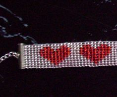 This is a Loom Beaded handmade Seed Bead Hearts Bracelet, it is 7 in length with a chain for added length.