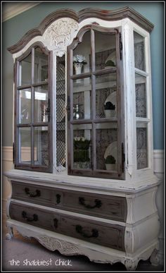 Revamping hutch using chalk paint....Old White & Coco; then put French script fabric on the back wall