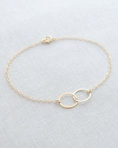Double Circle Bracelet by Olive Yew. This is a petite double circle bracelet that will compliment any outfit. Available in silver or gold.