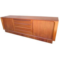 Excellent Danish Modern Tamboured Door Teak Credenza Plinth Base   From a unique collection of antique and modern credenzas at https://www.1stdibs.com/furniture/storage-case-pieces/credenzas/