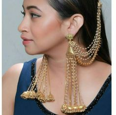 Add a little glam to your Indian wedding outfit by wearing these chic earrings. You can pair these trendy and classy earrings with any ethnic attire. OTT earrings will surely take your reception/haldi/mehndi/wedding outfit a notch higher. Indian Jewelry Earrings, Jewelry Design Earrings, Indian Wedding Jewelry, Ear Jewelry, Bridal Earrings, Designer Earrings, Bridal Jewelry, Indian Bridal, Bridal Accessories