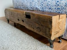 This beautiful reclaimed wood bench sits at the foot of the bed, adding a rustic touch to this newly-renovated master bedroom.