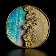 (No details on origin of this brooch.  Appears to be opal, gold, and diamonds or crystals.)