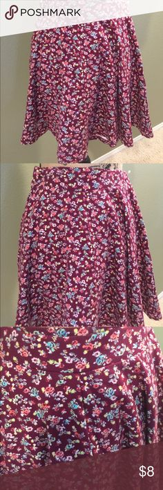 SO burgundy floral skater skirt. Very soft burgundy flowy floral skater skirt. Elastic waist band. Very cute on with any color top. Can be casual or dressed up. Skirts Mini