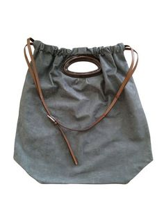 gray tote.. idea for rain proof bag protection