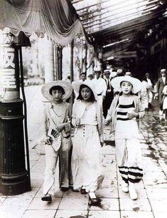 Modern Girls (moga) with beach pajamas on the street of Tokyo, 1928.