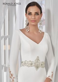 Estilo NLOZO TAI A ¾ length sleeved crepe dress with a glamorous beaded waist motif, cut out cuff detail and wide V back. Stunning Wedding Dresses, Bridal Wedding Dresses, Designer Wedding Dresses, Star Wars Wedding, Victoria Dress, Crepe Dress, Modern Fashion, One Shoulder Wedding Dress, Marie