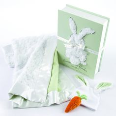 """A """"Bunnies In The Garden"""" gift set that includes a blanket, a tale, a cap, and a carrot rattle!"""