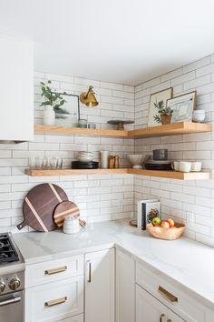 Oak Hills Kitchen Remodel: Modern white kitchen with subway tile + statement lighting by Lindsey Brooke Design | Corner Open Shelving